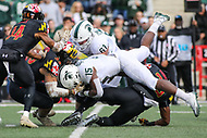College Park, MD - November 3, 2018: Michigan State Spartans running back La'Darius Jefferson (15) is tackled by several Maryland Terrapins defenders during the game between Michigan St. and Maryland at  Capital One Field at Maryland Stadium in College Park, MD.  (Photo by Elliott Brown/Media Images International)