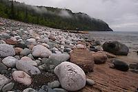 A cobblestone beach at Grindstone Point in Lake Superior Provincial Park near Wawa Ontario Canada.