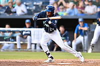 Asheville Tourists Daniel Montano (24) attempts to lay down a bunt during a game against the Lakewood BlueClaws at McCormick Field on August 3, 2019 in Asheville, North Carolina. The BlueClaws defeated the Tourists 10-6. (Tony Farlow/Four Seam Images)