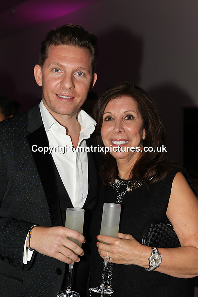 NON EXCLUSIVE PICTURE: TREVOR ADAMS / MATRIXPICTURES.CO.UK<br /> PLEASE CREDIT ALL USES<br /> <br /> WORLD RIGHTS<br /> <br /> British luxury property developer Nick Candy and his mother, Patricia attending the CANDY Magazine Autumn/Winter 2013 Launch Party, hosted by Nick Candy at the Saatchi Gallery in King's Road, London.<br /> <br /> OCTOBER 15th 2013<br /> <br /> REF: MTX 136759