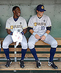 Charleston RiverDogs outfielder DeAngelo Mack (11), left, talks with outfielder Ray Kruml (37) in the dugout prior to a game against the Greenville Drive on May 27, 2010, at Fluor Field at the West End in Greenville, S.C.