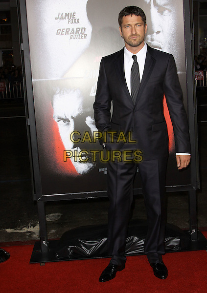 GERARD BUTLER.The Overature Film L.A. Premiere of Law Abiding Citizen held at The Grauman's Chinese Theater in Hollywood, California, USA. .October 6th, 2009 .full length grey gray suit black hand in pocket .CAP/ADM/KB.©Kevan Brooks/AdMedia/Capital Pictures.