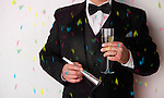 USA, Illinois, Metamora, Man with tuxedo holding champagne at party
