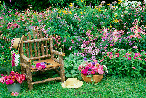His and her hats in blooming pastel garden, summer, Midwest USA