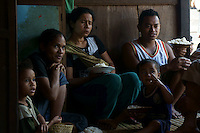 villagers share food during celebrations of building a new house in village Bena, Ngada people, Flores, Indonesia