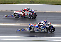 Apr. 28, 2013; Baytown, TX, USA: NHRA pro stock motorcycle rider Hector Arana Jr (near lane) races alongside his father Hector Arana Sr during the Spring Nationals at Royal Purple Raceway. Mandatory Credit: Mark J. Rebilas-