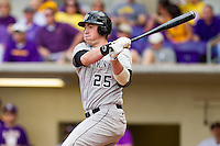 Matt Conway #25 of the Wake Forest Demon Deacons follows through on his swing against the LSU Tigers at Alex Box Stadium on February 19, 2011 in Baton Rouge, Louisiana.  The Tigers defeated the Demon Deacons 4-3.  Photo by Brian Westerholt / Four Seam Images