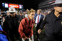 NWA Media/ J.T. Wampler - Alabama coach Nick Saban leaves the field after the Crimson Tide defeated Arkansas 14-13 Saturday Oct. 11, 2014.