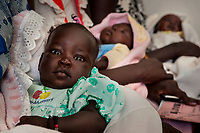 Babies await vaccines at the Munuki Healthcare Center in Juba, South Sudan educate patients on use of misquito nets in malaria prevention as well as other issues the regularly confront the community. The center deals with maternity, malaria, tuberculosis, HIV/AIDS and other common conditions. With funding from USAID, Jhpiego, an affiliate of Johns Hopkins University, operates the center.