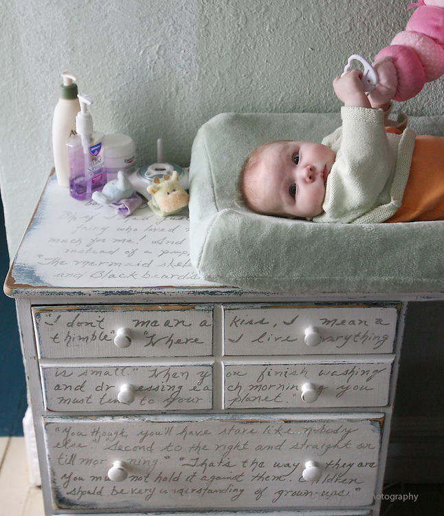 """The home of Scotty Walsh and Gina London in northwest Denver.   Isabella lies on top of her bureau, a thrift store find, which they repainted and scripted with quotes from the couple's favorite literature, including """"The Maltese Falcon."""" (ELLEN JASKOL/ROCKY MOUNTAIN NEWS)"""