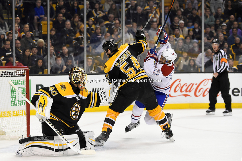 Saturday, October 10, 2105: Boston Bruins defenseman Adam McQuaid (54) works to keep /a21 from the net as goalie Tuukka Rask (40) gloves the puck during the NHL game between the Montreal Canadiens and the Boston Bruins held at TD Garden, in Boston, Massachusetts.Montreal defeats Boston 4-2 in regulation time. Eric Canha/CSM