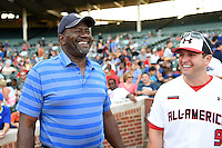 Lee Smith jokes with coach Jim Gemler (9) before throwing out the ceremonial first pitch during the Under Armour All-American Game on August 16, 2014 at Wrigley Field in Chicago, Illinois.  (Mike Janes/Four Seam Images)