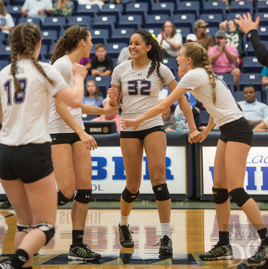 NWA Democrat-Gazette/ANTHONY REYES &bull; @NWATONYR<br /> Haley Warner (32) Fayetteville celebrates a point with teammates against North Little Rock Thursday, Oct. 27, 2016 during the 7A State Tournament at Wildcat Arena in Springdale. The Lady Bulldogs won 3-0 earning a berth in the 7A state championship against Springdale Har-Ber.