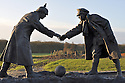 25/12/14<br /> <br /> A sculpture depicting two WW1 soldiers playing football during the famous Christmas Day truce in the field near Messine, Belgium, close to where the match was played in Flanders, Belgium.<br /> <br /> The sculpture, made in England, arrived in Flanders on Christmas Eve, and was first displayed in the town centre before being taken to the spot where the match was played. <br /> <br /> Sculpted by Andy Edwards the work is entitled &lsquo;All Together Now&rsquo;, recalling the song by the band The Farm - which was inspired by the truce. <br /> <br /> Chris Butler said: &ldquo;Castle Fine Arts are proud to have cast a number of war memorials over the years. We are honoured to support this sculpture for peace. I believe it will touch the hearts of millions.&rdquo;<br /> <br /> <br /> &ldquo;It will be a symbol of peace and hope and a call for a renewed worldwide cessation of violence in honour of those brave boys who &lsquo;joined together and decided not to fight&rsquo;&rdquo;.<br /> <br /> <br /> The statue depicts the meeting of a British and a German soldier over a football, deep in the mud between the lines on that first Christmas of the war. The soldiers appear to be shaking hands but  are not not quite touching, forming a space in which a visitor can insert their own hand to complete the union.  A chance for a moments reflection on how far we are from true peace and brotherhood and the part each of us has to play in that dream. We want the work to stand as both a celebration of this inspirational and heroic event and as symbol of hope and peace. <br /> <br /> The project was instigated some years ago, with the support of the Football Asscociation (FA), as football&rsquo;s contribution to the First World War commemorations. <br /> <br /> All Rights Reserved - F Stop Press. www.fstoppress.com. Tel: +44 (0)1335 300098