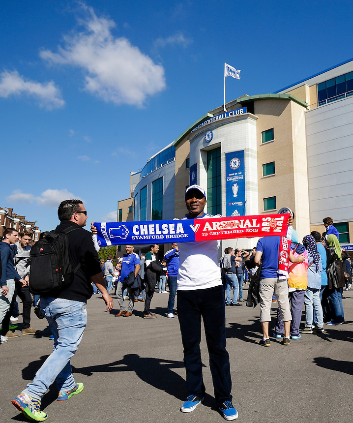 A fan poses with a match day scarf outside Stamford Bridge, home of Chelsea<br /> <br /> Photographer Craig Mercer/CameraSport<br /> <br /> Football - Barclays Premiership - Chelsea v Arsenal - Saturday 19th September 2015 - Stamford Bridge - London<br /> <br /> &copy; CameraSport - 43 Linden Ave. Countesthorpe. Leicester. England. LE8 5PG - Tel: +44 (0) 116 277 4147 - admin@camerasport.com - www.camerasport.com