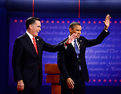 United States President Barack Obama, the Democratic Party nominee for President, and former Massachusetts Governor Mitt Romney, the Republican Party nominee for President, wave to supporters as they begin the first Presidential Debate of the 2012 General Election at the University of Denver in Denver, Colorado on Tuesday, October 2, 2012..Credit: Ron Sachs / CNP.(RESTRICTION: NO New York or New Jersey Newspapers or newspapers within a 75 mile radius of New York City)