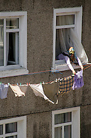 Woman putting out washing, Beyoglu, Istanbul, Turkey