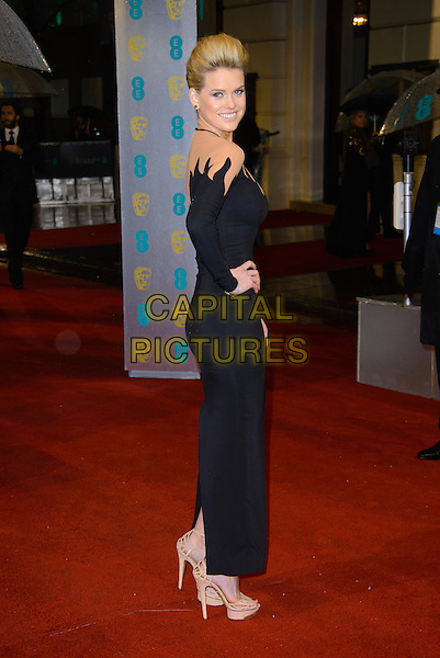 Alice Eve.EE British Academy Film Awards at The Royal Opera House, London, England 10th February 2013.BAFTA BAFTAS arrivals   full length black dress pattern flame sheer hand on hip beige platform shoes side .CAP/CJ.©Chris Joseph/Capital Pictures