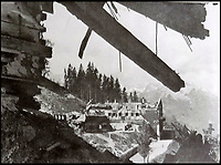 BNPS.co.uk (01202 558833)<br /> Pic: DavidDuggleby/BNPS<br /> <br /> Not so happy valley - A view of Hitlers ruined Berghof from Martin Bormanns equally devastated home after an RAF raid in April 1945.<br /> <br /> This amazing photo album reveals the close knit alpine community where Hitler and his henchmen worked and played.<br /> <br /> The album was brought back to Britain by a British administrator of the railways in post war Germany and reveals the cosy living arrangements of the high ranking Nazi's of Hitlers Third Reich.<br /> <br /> It shows the homes of Hitler, Martin Boorman and Hermann Goering in tiny Berchtesgaden in Bavaria, and also the infamous Eagles Nest on a mountain top nearby where the evil dictator would dream his dreams whilst taking in the stunning vista.<br /> <br /> The unique album is being sold by David Duggleby auctioneers in Scarborough on the 7th October.
