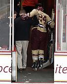 Bert Lenz (BC - Director, Sports Medicine), Bill Arnold (BC - 24) - The Boston College Eagles defeated the visiting University of Vermont Catamounts to sweep their quarterfinal matchup on Saturday, March 16, 2013, at Kelley Rink in Conte Forum in Chestnut Hill, Massachusetts.