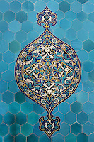 Tile decoration from the Green Tomb or Yesil Turbe, mausoleum of the 5th Ottoman Sultan Mehmed I Celebi, Bursa, Turkey. These tiles are on the interior wall and depict an ornate floral pattern on a background of hexagonal turquoise tiles. The tomb was built by Mehmed's son and successor Murad II following Mehmed's death in 1421 and is so named because of the green-blue tiles which cover the exterior. The architect, Haci Ivaz Pasha, designed the tomb and the Yesil Mosque opposite. Picture by Manuel Cohen
