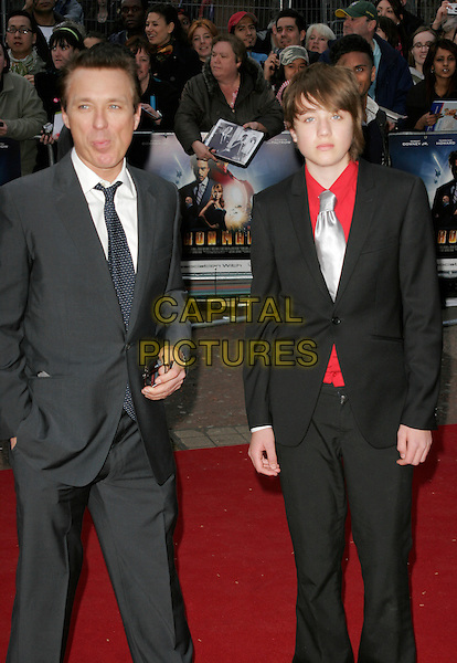 """MARTIN KEMP & SON.UK Premiere of """"Iron Man"""" at the Odeon, Leicester Square, London, England. .April 24th 2008.full length 3/4 black suit gray gray shirt red father dad family .CAP/AH.©Adam Houghton/Capital Pictures."""