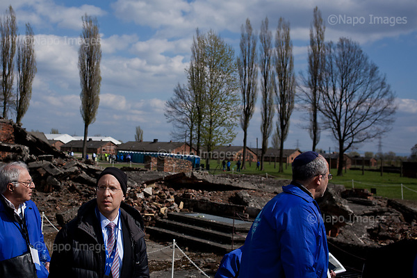 OSWIECIM, POLAND, APRIL 24, 2017:<br /> Elisha Wiesel is reflecting by the ruins of the crematorium, with from Syndey Amir and Sydney Amir, during the &quot;March of The Living&quot; an annual march between two camps of the Auschwitz concentration camp.  Elisha Wiesel is a chief technology officer at Goldman Sachs in New York and the only son of Holocaust memoirist Eli Wiesel. After death of his father he has decided to step forward and take a more public role, carrying on his father's work.<br /> (Photo by Piotr Malecki / Napo Images)<br /> ###<br /> OSWIECIM, 24/04/2017:<br /> Elisha Wiesel, syn slawnego Eli Wiesela, bierze udzial w Marszu Zywych w Oswiecimiu. Po smierci ojca Elisha postanowil kontynuoawc jego dzielo.<br /> Fot: Piotr Malecki / Napo Images<br /> <br /> ###ZDJECIE MOZE BYC UZYTE W KONTEKSCIE NIEOBRAZAJACYM OSOB PRZEDSTAWIONYCH NA FOTOGRAFII###