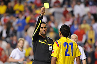 John Javier Restrepo (21) of Colombia (COL) gets a yellow card from referee Roberto Garcia. The men's national teams of the United States (USA) and Colombia (COL) played to a 0-0 tie during an international friendly at PPL Park in Chester, PA, on October 12, 2010.