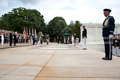 Arlington, VA - May 25, 2009 -- United States President Barack Obama and Major General Richard Rowe, commander of the Military District of Washington, D.C., place a wreath at the Tomb of the Unknown Soldier during Memorial Day Ceremonies at Arlington National Cemetery in Arlington, VA., U.S.,  Monday, May 25, 2009.  .Credit: Joshua Roberts - Pool via CNP