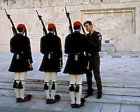 01 NOV 2003 - ATHENS, GREECE - An officer checks an Evzones uniform at the Changing of the Guard ceremony in front of the Tomb of the Unknown Soldier. (PHOTO (C) NIGEL FARROW)