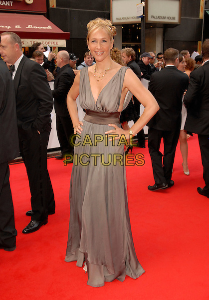 TANIA BRYER.Red Carpet Arrivals at The British Academy Television Awards (BAFTA) Sponsored by Pioneer, held at the London Palladium, London, England, May 20th 2007..full length grey long maxi dress hand on hip tanya.CAP/FIN.©Steve Finn/Capital Pictures.