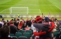 DFB Pokal 2011/12 2. Hauptrunde RasenBallsport Leipzig - FC Augsburg Das RB Maskottchen mit Fans.