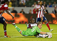 CARSON, CA - October 20, 2012: Chivas USA goalie Tim Melia (28) and Colorado Rapids forward Omar Cummings (14) during the Chivas USA vs Colorado Rapids match at the Home Depot Center in Carson, California. Final score, Chivas USA 0, Colorado Rapids 2.