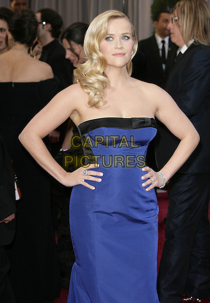 Reese Witherspoon (wearing Louis Vuitton).85th Annual Academy Awards held at the Dolby Theatre at Hollywood & Highland Center, Hollywood, California, USA..February 24th, 2013.oscars half length dress hands on hips black strapless cobalt blue   .CAP/ADM.©AdMedia/Capital Pictures.