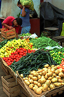 Vegetable stand with potatoes and peppers in the town market. Patzcuaro Michoacan Mexico.