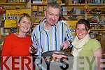 SAMPLE: Eileen and Thomas Ashe, Butchers of Annascaul give a sample of their home-made sausages with black and white puddings to Shonadh O'Sullivan, Castlegregory in Foxy John's pub, Dingle during the Tasty Trail at the Dingle food fair on Saturday.
