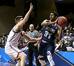 SIOUX FALLS, SD: MARCH 22: Gokul Natesan #31 from Colorado Mines loos to pass the ball around Rusty Troutman #5 from Bellarmine during the Men's Division II Basketball Championship Tournament on March 22, 2017 at the Sanford Pentagon in Sioux Falls, SD. (Photo by Dave Eggen/Inertia)