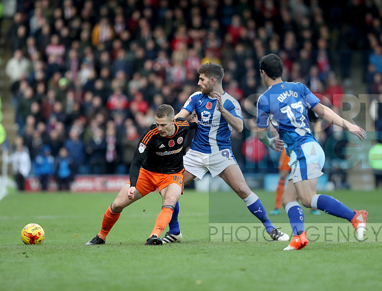 Paul Coutts of Sheffield United tussles with Ched Evans of Chesterfield during the English Football League One match at Proact Stadium, Chesterfield. Picture date: November 13th, 2016. Pic Jamie Tyerman/Sportimage
