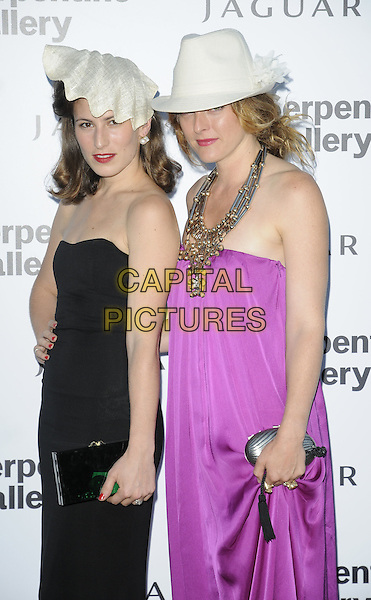 CHARLOTTE DELLAL & ALICE TEMPERLEY .At the Serpentine Gallery Summer Party, Serpentine Gallery, Hyde Park, London, England, UK, July 8th 2010..half length strapless pink purple magenta hand on hip silk dress trilby hat fedora white necklace metal silver black clutch bag .CAP/CAN.©Can Nguyen/Capital Pictures.