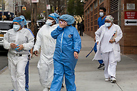 NEW YORK, NY - April 14: A group of medical workers are seen as they receives free meals outside Wyckoff Heights Medical Center on April 14, 2020 in Brooklyn, NY. The global number of deaths from COVID-19 has reached 122,000 and infected more than 1.9 million people. Experts believe the number may be greater. (Photo by Pablo Monsalve / VIEWpress via Getty Images)