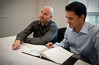 Norwegian employees of the European company StatOil, Thomas Johansen (cq, 32, left), a completion engineer from Matrand, and Eivind Vamraak (cq, 37) a mid steam engineer, from Stavanger, discuss shale deposits at Chesapeake Energy's headquarters in Oklahoma City, OK, Thursday, Sept., 23, 2009. Chesapeake Energy has a new program to work with foreign companies to help train on new shale technology...PHOTOS/ MATT NAGER