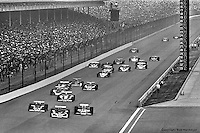 INDIANAPOLIS, IN: George Snider #18, Johnny Rutherford #2 and Al Loquasto #86 lead a group of cars into Turn 1 during the Indianapolis 500 on May 29, 1977, at the Indianapolis Motor Speedway.