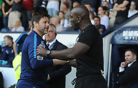 Tottenham Hotspur manager Mauricio Pochettino and West Bromwich Albion Caretaker manager Darren Moore exchange hand shakes<br /> <br /> Photographer Ashley Crowden/CameraSport<br /> <br /> The Premier League - West Bromwich Albion v Tottenham Hotspur - Saturday 5th May 2018 - The Hawthorns - West Bromwich<br /> <br /> World Copyright &copy; 2018 CameraSport. All rights reserved. 43 Linden Ave. Countesthorpe. Leicester. England. LE8 5PG - Tel: +44 (0) 116 277 4147 - admin@camerasport.com - www.camerasport.com