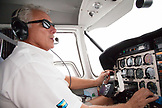 EXUMA, Bahamas. The pilot flying the prop plane towards the Exuma Islands.