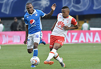 BOGOTA - COLOMBIA -16 -07-2017: Jair Palacios (Izq) jugador de Millonarios disputa el balón con John Pajoy (Der) jugador de Independiente Santa Fe durante partido por la fecha 2 de la Liga Aguila II 2017 jugado en el estadio Nemesio Camacho El Campin de la ciudad de Bogota. / Jair Palacios (L) player of Millonarios fights for the ball with John Pajoy (R) player of Independiente Santa Fe during match for the date 2 of the Liga Aguila II 2017 played at the Nemesio Camacho El Campin Stadium in Bogota city. Photo: VizzorImage / Gabriel Aponte / Staff.