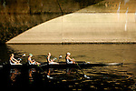 Rowers pass under a bridge after crossing the finish line during the 68th Dad Vail Regatta on the Schuylkill River in Philadelphia, Pennsylvania on May 12, 2006..............