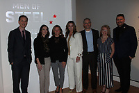 NWA Democrat-Gazette/CARIN SCHOPPMEYER Rod Bigelow, Crystal Bridges Museum of American Art executive director and chief diversity and inclusion officer (from left), Kellie Shetler, Tracey Kenny, Katie Holley, Matt and Camas Maroney and Alejo Benedetti, Crystal Bridges assistant curator gather at the debut of Men of Steel, Women of Wonder on Thursday Feb. 7 at the museum in Bentonville.