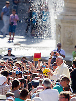 Papa Francesco tiene la sua centesima udienza generale del mercoledi' in Piazza San Pietro, Citta' del Vaticano, 26 agosto 2015.<br /> Pope Francis holds a ball thrown by the faithful as he arrives for his hundredth weekly general audience in St. Peter's Square at the Vatican, 26 August 2015.<br /> UPDATE IMAGES PRESS/Riccardo De Luca<br /> <br /> STRICTLY ONLY FOR EDITORIAL USE