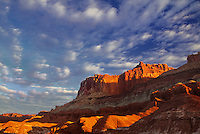 731350058 light clouds hover over the waterpocket fold sandstone formation in capitol reef national park utah