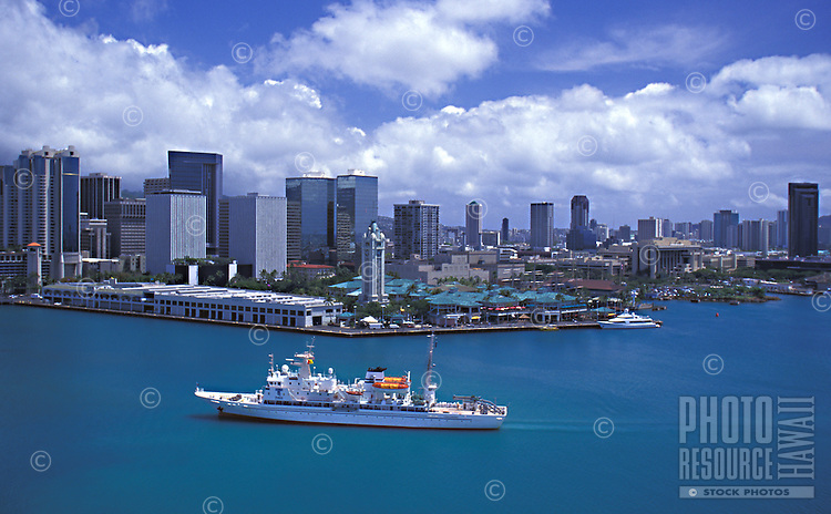 Aerial view of Aloha Tower with ship docking, and downtown Honolulu in the background